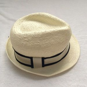 New straw hat, ivory with black ribbon